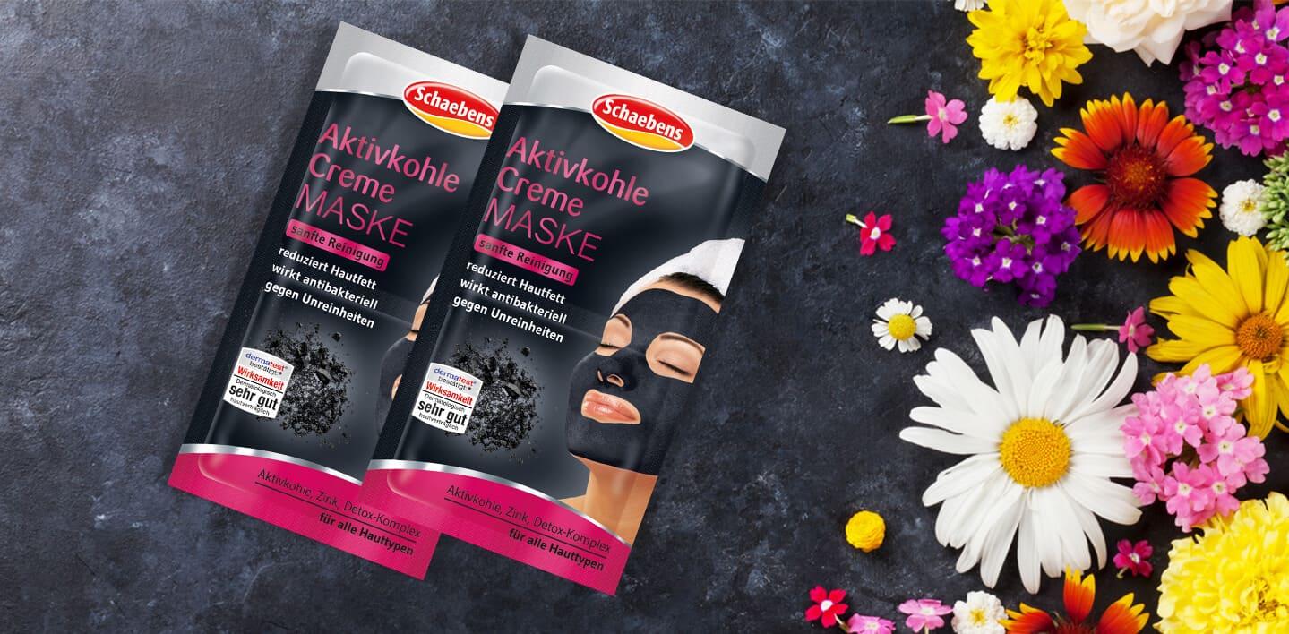 aktivkohle-creme-maske-gesichtspflege-pflege-gesichtsmaske-maske-schaebens-zink-detox-komplex-antibakteriell-verfeinert-reinigend-schützt-regeneration-sanft-header-schwarz-pink-blumen
